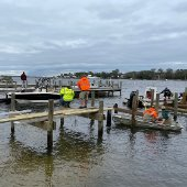 boat launch with staff working on dock.