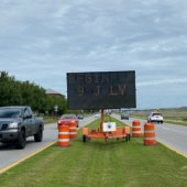 message board along Airport Road
