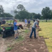 parks and recreation staff and Destin Forward Class laying sod at the Destin Dog Park