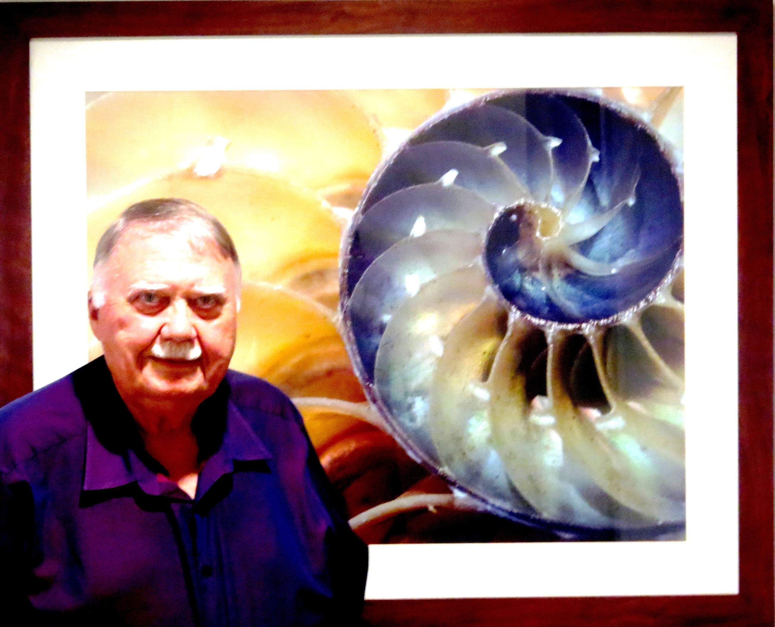 picture of H. C. Hank Klein standing in front of artwork