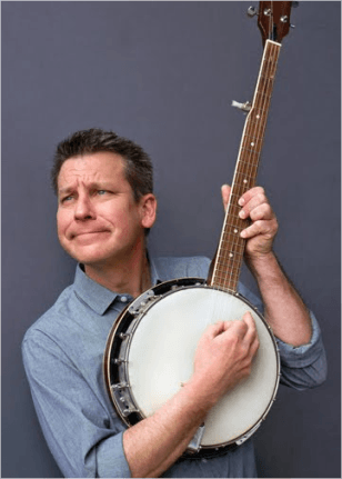 Picture of Jim Gill holding an instrument