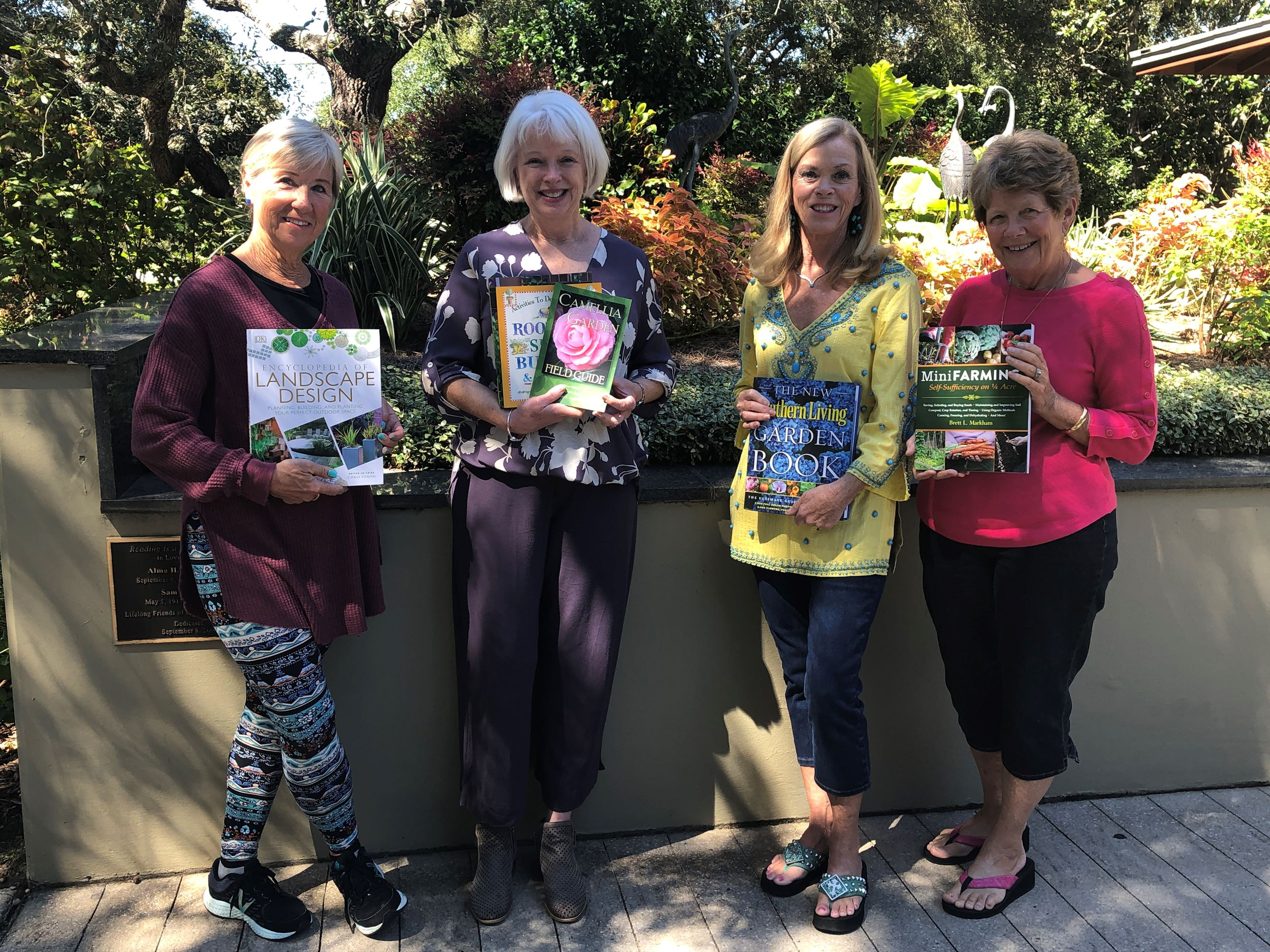 A picture of Destin Library Director Wen Livingston and members of the Destin Gardening Club
