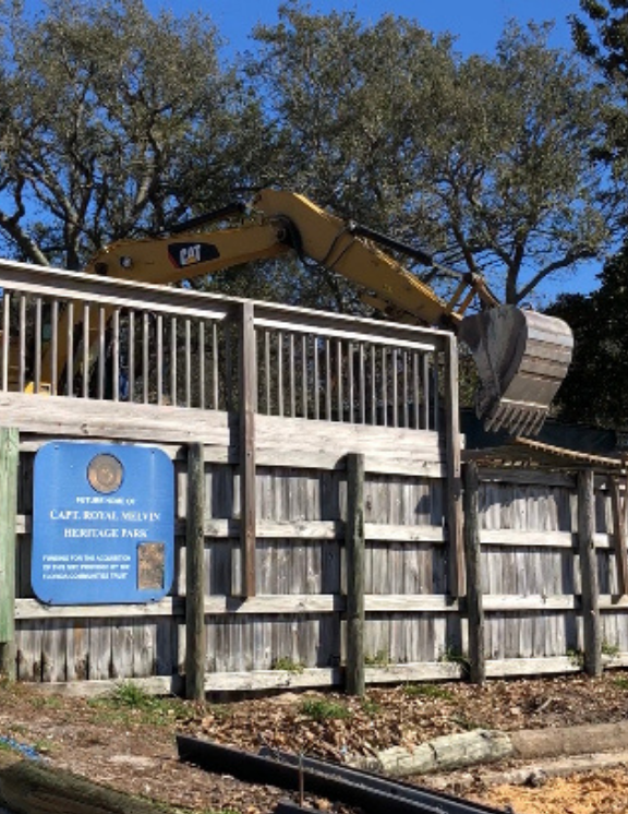 Photo of the sign fence at Captain Royal Melvin being torn down