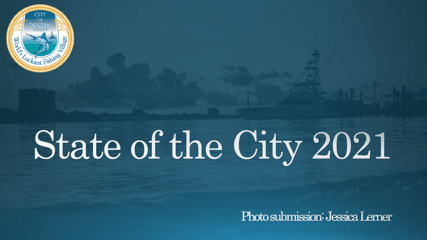 A picture of a boat in the Destin Harbor with State of the City 2021 written across the photo